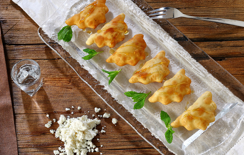 Sour Mezeethra cheese fried pastries